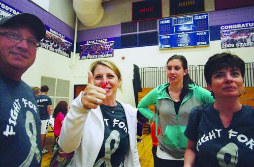 Families unite at basketball game against cancer