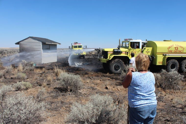 Small brush fire extinguished with help from neighbors ...