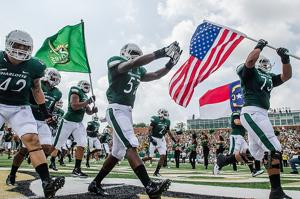 UNCC wins first game