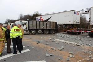 Emeregnecy service workers respond to a wreck at the Shamrock Road railroad crossing in Harrisburg