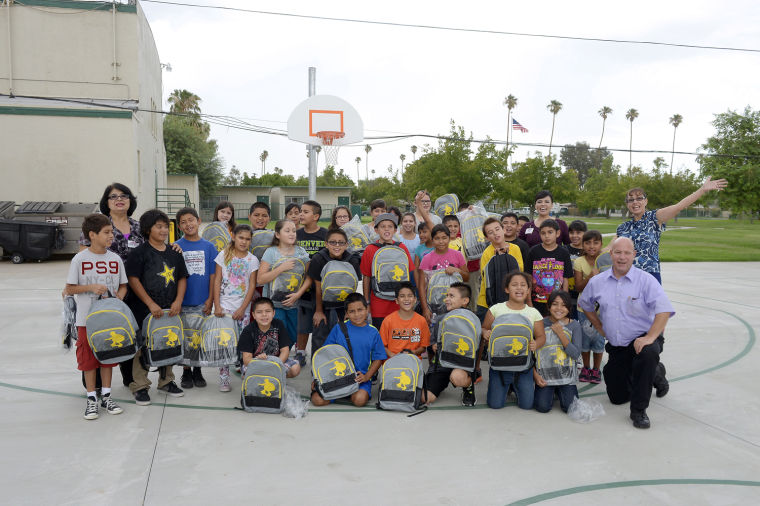 Finley Elementary School Students Receive Backpacks From