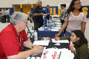 Students weigh their options at college fair