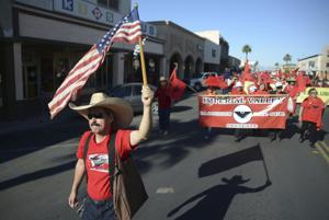 Cesar Chavez supporters march through Calexico