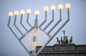 Son of Israeli woman killed in Berlin terror attack lights menorah in German capital