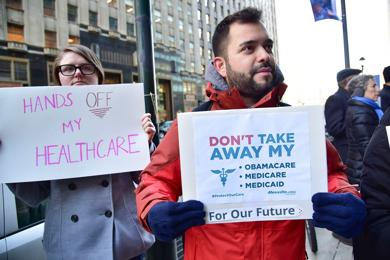 <p>Protestors rally in support of the Affordable Care Act in Philadelphia on Dec. 20, 2016.</p>