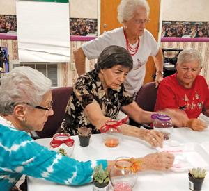 "<p>Seniors participate in a ""Planting with Crystals""craft activity, using a hydroponic planting technique, at the JFCS Center for Senior Enrichment.</p><p>Photo courtesy of Tami Simmons</p>"