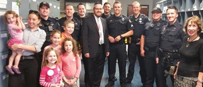 <p>Members of Ahavas Torah in Scottsdale show support for the city's police officers by delivering pizza and Gatorade, as well as cards and messages of thanks, to the officers.</p><p>Photo courtesy of Ahavas Torah</p>