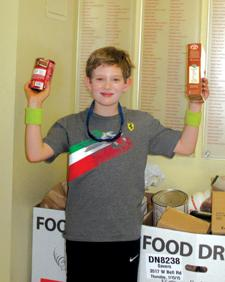<p><span>Michael collects food for St. Mary's Food Bank.</span></p><p><em> </em></p>