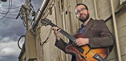 "<p>Jazz guitarist Jeff Libman, a professor at Arizona State University, releases his new CD, ""Strange Beauty,"" this month.          </p><p><em> </em></p>"