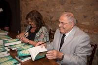 """<p>Author Wendy Holden and Holocaust """"survivor baby"""" Mark Olsky autograph Holden's book, """"Born Survivors: Three Young Mothers and Their Extraordinary Story of Courage, Defiance and Hope.""""</p>"""