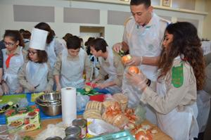 <p>Children prepare Israeli foods at Shemet Shemesh's Shevet Cook Day on Jan. 22.</p>