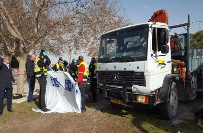 <p>Members of ZAKA search and rescue organization gather human remains from a truck-ramming attack in eastern Jerusalem that killed four Israeli soldiers and injured 15 others, Jan. 8, 2017. </p>
