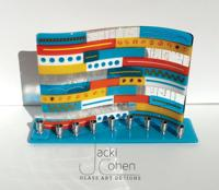 <p><span>Examples of Jacki Cohen's colorful fused-glass pieces include a Hanukkah menorah, a hamsa, decorative hearts and Stars of David. </span></p><p><em></em></p>