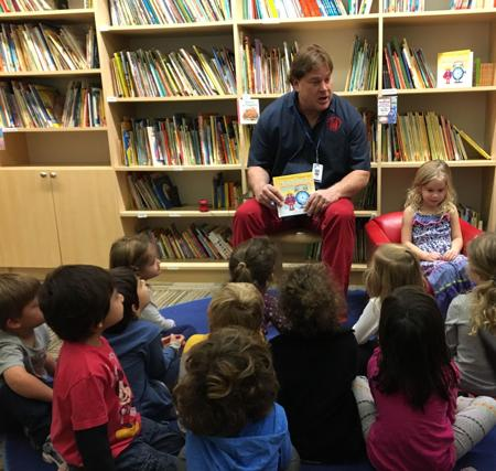 "<p>Author David John visits his daughter's preschool, the Valley of the Sun JCC's Early Childhood Center, where he gave each of the children a copy of his book ""The Time Frame Game,"" along with its companion app.   </p>"