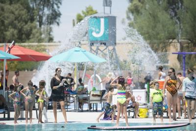 <p>More than 700 people attended the Valley of the Sun Jewish Community Center's Aug. 21 pool party, celebrating the grand opening of the VOSJCC's new aquatics center. The new center has a competition pool, an activity pool, a 2,500-square-foot splash pad with a 30-gallon splash tower and a climbing wall. To learn about the VOSJCC's aquatics programs, visit vosjcc.org/aquatics-center.</p>