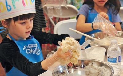 <p>About 300 people attended the Mega Challah Bake 4 Kids! at Chabad of Arizona on Sept. 18. The event, co-chaired by Gabi Messinger and Dede Sandler, was hosted by the Friendship Circle, Alef Bet Preschool, Temple Solel and the Valley of the Sun JCC Early Childhood Center. In addition to challah baking, the program also included entertainment, activities and crafts.</p><p>Photo courtesy of Elena and Jim Thornton</p><p></p>
