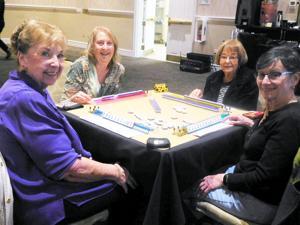<p>Playing mah-jongg are, from left, Nancy Keane, Barbara Paules, Shirley Harris and Harriette Scaringelli.</p>