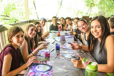 <p>Campers at Congregation Beth Israel's Camp Daisy & Harry Stein get creative – and a little messy – during an art session at the Prescott camp. Send camp photos to photos@jewishaz.com.</p>