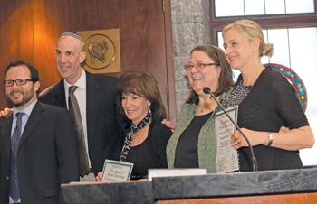 <p><span>Graduates Sue Cohen, third from left, and Chantelle Sabbath, right, present a class gift: the establishment of a scholarship fund for future Melton students. Also pictured are, from left, Rabbi Jeremy Schneider, Rabbi Rony Keller and Rabbi Tracee Rosen, Melton Phoenix director.   </span></p><p><span></span></p>