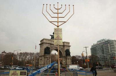 <p>The Chabad menorah at Grand Army Plaza, whose candles reach 33 and a half feet in the air, is technically taller than its Manhattan rival. (Facebook)</p>