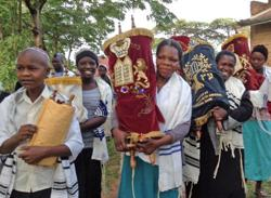 <p>In anticipation of the construction of a new synagogue in Nabagoye, Uganda, the women and children there were given the honor of transferring the Torahs from the old synagogue to a temporary home.     </p><p>Photo courtesy of Be'chol Lashon</p>