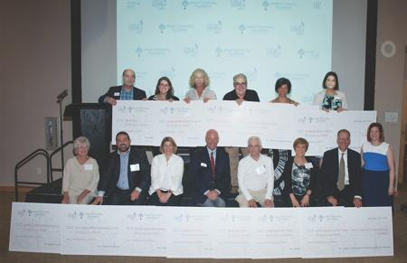 <p>Representatives from 12 Valley agencies receive $10,000 grants from the Jewish Community Foundation through JCF's Life & Legacy program at a May 10 luncheon.</p>