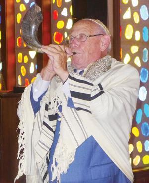 <p>Harvey Fein blows the shofar at Sun Lakes Jewish Congregation.  </p><p></p><p>Photo by Allan Levy</p>