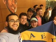 <p>Rabbi Mendy Rimler of Chabad at ASU, left, joins the brothers of newly reinstated AEPi at ASU at a late-night basketball game.</p>