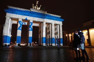 <p>Berlin's Brandenburg Gate displays an image of an Israeli flag Monday night in a show of solidarity with the Jewish state after a Palestinian attacker rammed a truck into a crowd of soldiers visiting the promenade in Jerusalem's Armon Hanatziv neighborhood the night before, killing four.</p>