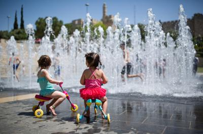 <p>Children play in a water fountain near the Tower of David in the Old City of Jerusalem on April 17, 2016.</p>