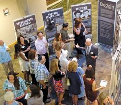 """<p>Dr. Bjorn Korndorfer, director of the Martin-Springer Institute, talks to guests at the Sept. 11 opening reception of """"Through the Eyes of Youth: Life and Death in the Bedzin Ghetto.""""</p><p>Photo courtesy of the Martin-Springer Institute</p>"""
