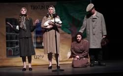 """<p>""""Life in a Jar: The Irena Sendler Project"""" was presented by the East Valley JCC, the Greater Phoenix Jewish Film Festival and the City of Chandler on Jan. 12 at the Chandler Center for the Arts. The backdrop for the play says """"Tikkun Olam"""" in both English and Hebrew.</p>"""