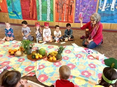 <p>Cantor Raina Sinclair leads a Tu B'Shevat seder for the 3's and Pre-K classes at the Temple Kol Ami Early Chldhood Center. She also designed the trees and each class decorated them with leaves. The children, from left, are: Rosslyn, Grant, Emerson, Samantha, Skyler and Danny. Tu B'Shevat, a holiday celebrating the birthday of trees, was Feb. 11.</p>