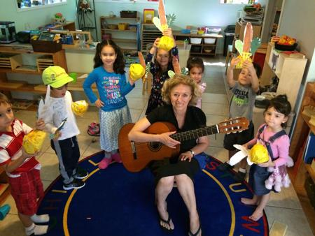 <p>Nurit Avigdor leads Emunah Montessori Academy students in a Sukkot song about a lulav and etrog during a music class at the Phoenix school.</p>