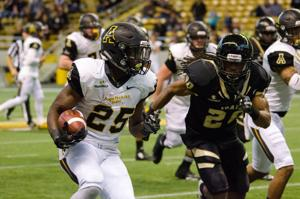 Running back Jalin Moore (25) set a freshman record for rushing yards in a single game with 244 in App State's win at Idaho. (Allyson Lamb/App State Athletics)