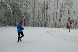 <p>IN TRAINING - Tony Blevins was out running before 8 a.m. Thursday in the Farmington subdivision south of Wilkesboro as he prepares to enter the Grandfather Mountain Marathon. Blevins, 50, said running in snow is a particularly good workout.</p>