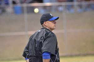 <p>DWAYNE BERRIER, seen here coaching first base during a North Wilkes baseball game in 2014, previously served as head coach of the Vikings' softball team for three seasons.</p>
