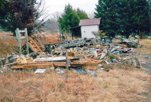 <p>BURNED TRAILER is just off N.C. 268 East in Ronda. Residents are asking the Ronda town board to help get the property cleaned up.</p>