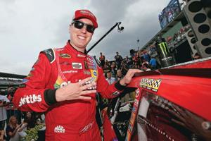<p>KYLE BUSCH, driver of the #18 Skittles Toyota, places the winner's decal in Victory Lane after winning the NASCAR Sprint Cup Series Crown Royal Presents the Jeff Kyle 400 at the Brickyard at Indianapolis Motor Speedway on Sunday.</p>