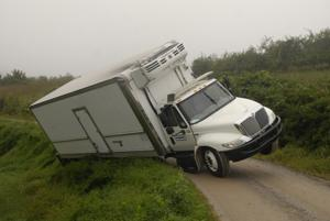 Box truck ran off Moore Mountain Road near county line when detoured.