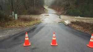 <p>TWIN LOCUST ROAD was closed Wednesday due to the East Prong of Roaring River overflowing the bridge over the steam near where Twin Locust intersects with Grissel Tail Road.</p>