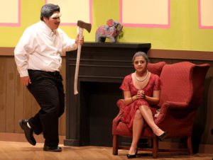 Killeen High School Murder Mystery Production: Ben Sanchez who plays the part of Bunting carries an axe as Courtney Benitez who plays the part of Mildred looks on during the production of