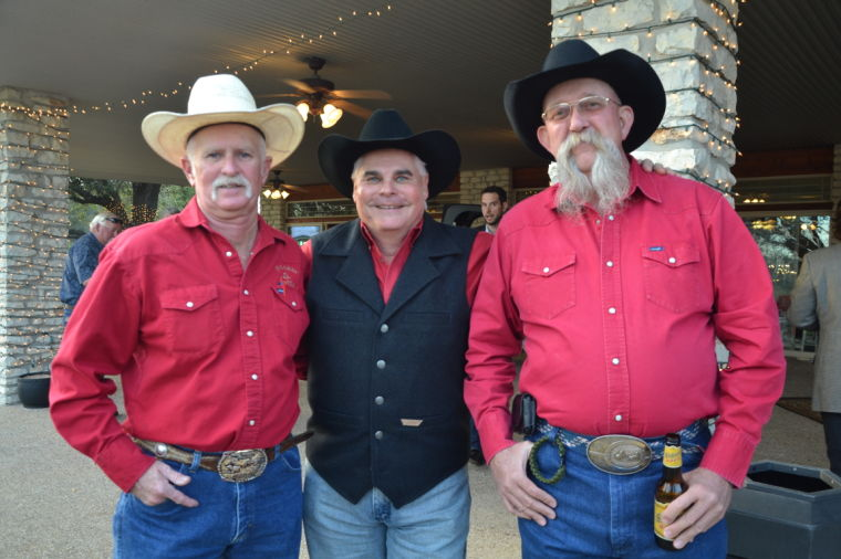 """From left, Bill Hall, Charlie Sheffield and Richard """"Pee-Wee"""" Reaves of the Robin Hood Auctioneer crew."""