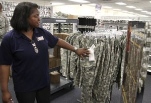 Army Combat Uniform Alternate: Tammer Tracey, store manager, points to the Army Combat Uniform Alternate versions Wednesday morning at the Military Clothing Store on Fort Hood. - Herald/MARIANNE LIJEWSKI