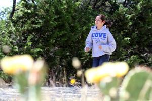 Cove distance runner commits to Rice