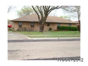 Spacious home located on a corner lot and side entry