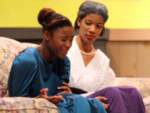 Killeen High School Murder Mystery Production: Nelly Davis who plays the part of Dorothy cries as Jonicia Blackburn who plays the part of Margaret Craddock consoles her during the production of