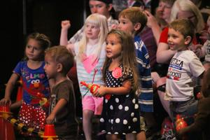 <p>Young audience member watch the Sesame Street/USO Experience for Military Families on Sept. 10, 2014.</p>
