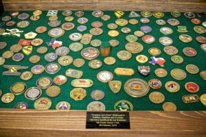 Coins (3): Coins are displayed in a case in the foyer at North Side Baptist Church. The coins have been collected as part of the children's Master Club Program. - Jodi Perry