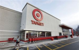 Target Data Breach: A passer-by walks near an entrance to a Target retail store Thursday, Dec. 19, 2013 in Watertown, Mass. Target says that about 40 million credit and debit card accounts may have been affected by a data breach that occurred just as the holiday shopping season shifted into high gear. (AP Photo/Steven Senne) - Steven Senne